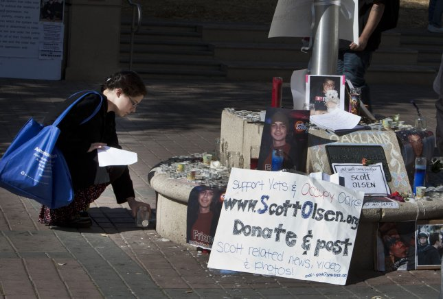 A small shrine is set up for injured Iraqi war veteran Scott Olsen at a new encampment in Frank H. Ogawa Plaza in Oakland, California on October 28, 2011. Olsen suffered serious head injuries after being hit by a projectile fired by police during the Occupy Oakland protests. UPI/Terry Schmitt