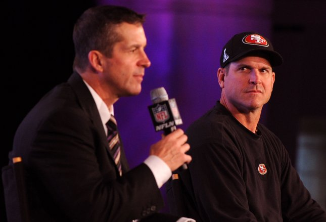 San Francisco 49ers head coach Jim Harbaugh (R) watches as his brother Baltimore Ravens head Coach John Harbaugh speaks during a joint press conference on Super Bowl XLVII in New Orleans on February 1, 2013. The two will play each other in the Super Bowl on February 3. UPI/Kevin Dietsch