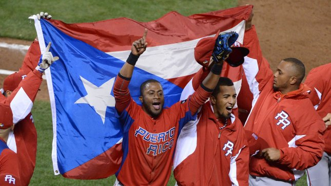 Puerto Rican players celebrate after defeating Japan 3-1 in the semi finals of the World Baseball Classic at AT&T Park in San Francisco on March 17, 2013. Rios hit a two run homer. UPI/Terry Schmitt