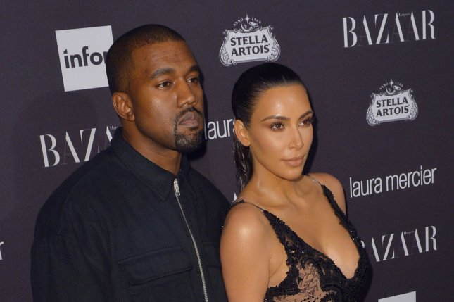 Kanye West (L) and Kim Kardashian at the Harper's Bazaar Icons party on September 9. File Photo by Andrea Hanks/UPI