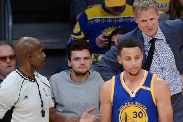 Golden State Warriors point guard Stephen Curry (R) argues the call as head coach Steve Kerr chimes in during a game against the Los Angeles Lakers at Staples Center in Los Angeles on November 4, 2016. Looking on from their court side seats are actor Jack Nicholson and his son Raymond Nicholson. Photo by Jim Ruymen/UPI