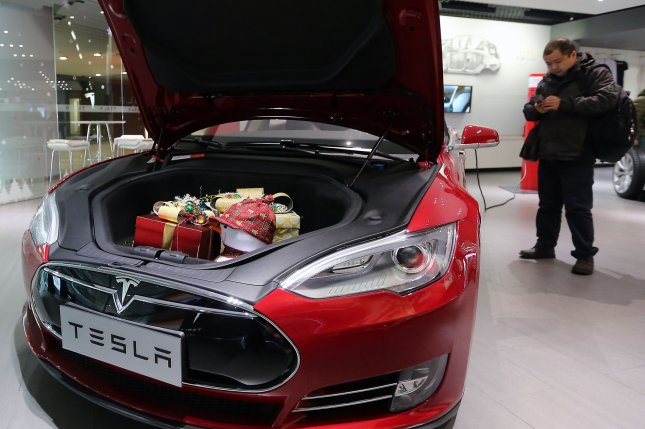 Tesla extended the battery capacity for some of its vehicles, giving Hurricane Irma evacuees between 30 and 40 extra miles on a battery charge. File Photo by Stephen Shaver/UPI