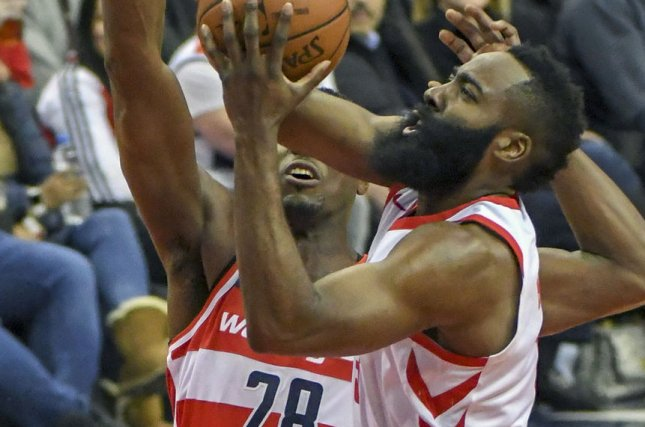 Houston Rockets guard James Harden (13) scores against Washington Wizards center Ian Mahinmi (28) in the first half at Capital One Arena on December 29 in Washington, D.C. File photo by Mark Goldman/UPI