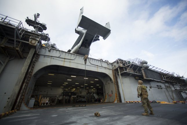U.S. Marines assigned to Maritime Raid Force, 22nd Marine Expeditionary Unit conduct a fast rope training exercise aboard the amphibious assault ship USS Wasp. File Photo by Koby I. Saunders/U.S. Marine Corps/UPI