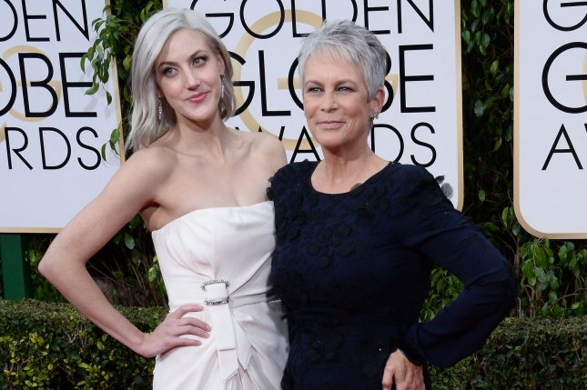 Jamie Lee Curtis (R), pictured with Annie Guest, said she's grateful to have survived a secret, 10-year addiction to opiates. File Photo by Jim Ruymen/UPI