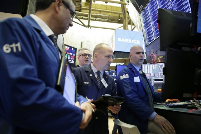 Traders work on the floor of the New York Stock Exchange at the opening bell on Wednesday, the first day of trading for 2019. Photo by John Angelillo/UPI