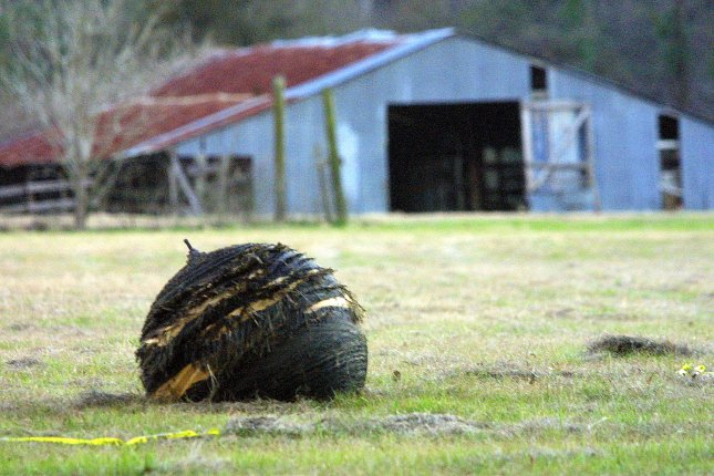 A piece of the space shuttle Columbia dropped in a pasture just outside of San Augustine, Texas, on February 1, 2003. File Photo by Joe Mitchell/UPI