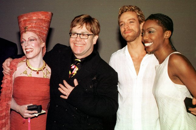 A revival is in the works of Elton John's stage musical, Aida. He is pictured here in 2000 with original cast members Sherie Rene Scott, Adam Pascal and Heather Headley. File Photo by Ezio Petersen/UPI