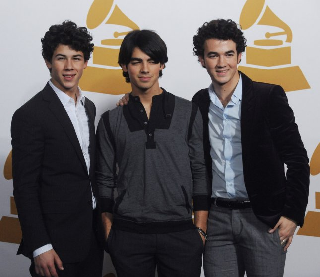 Pop group The Jonas Brothers (from L) Nick, Joe and Kevin Jonas, appear in the photo room at The Grammy Nominations Concert Live!: Countdown to Music's Biggest Night in Los Angeles on December 3, 2008. The group received a Grammy nomination for Best New Artist as nominations were announced at the concert. (UPI Photo/Jim Ruymen)