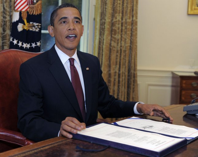 U.S. President Barack Obama signs the Supplemental Appropriations Act in the Oval Office of the White House in Washington on June 24, 2009. The signing adds military funding for the wars in Iraq and Afghanistan. (UPI Photo/Mike Theiler/Pool)
