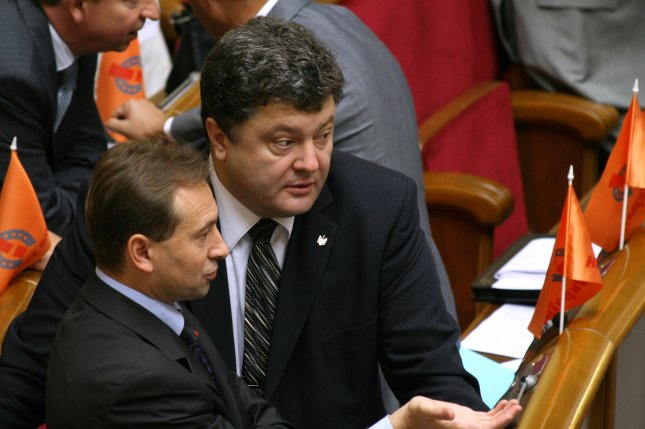 Petro Poroshenko (R) in 2006. (UPI Photo/Sergey Starostenko)