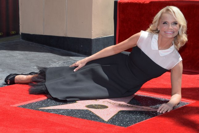 Actress Kristin Chenoweth sits beside her star during an unveiling ceremony honoring her with the 2,555th star on the Hollywood Walk of Fame in Los Angeles on July 24, 2015. Photo by Jim Ruymen/UPI