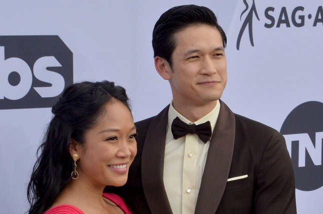 Harry Shum Jr. (R) and his wife Shelby Rabara. The couple announced on social media that their first child has been born. File Photo by Jim Ruymen/UPI.