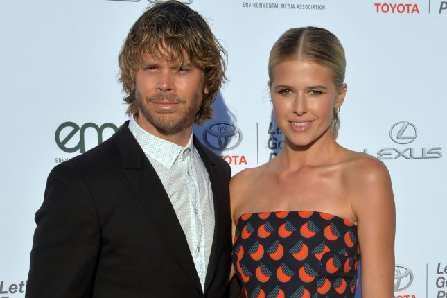 Actor Eric Christian Olsen (L) and his wife, actress Sarah Wright Olsen, are expecting their third child. File Photo by Jim Ruymen/UPI