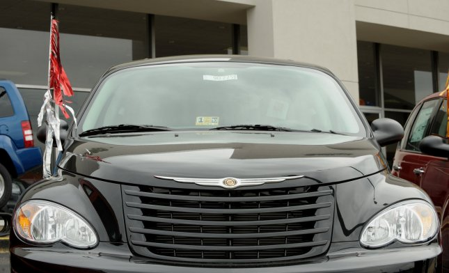 A Chrysler PT Cruiser is seen on the lot at a Chrysler-Jeep-Dodge dealership in Springfield, Va., on April 30, 2009.