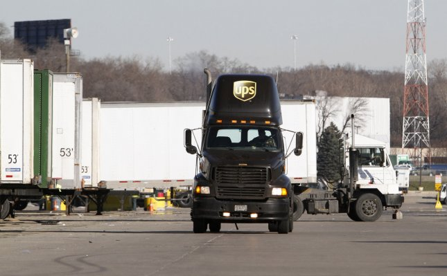 Trucks move trailers at United Parcel Service's Chicago Area Consolidation Hub on December 16, 2009 in Hodgkins, Illinois. Bolstered by holiday shipping, over 2 million packages were expected to pass through the location on Wednesday, the busiest day of the year for the world's largest package sorting facility. UPI/Brian Kersey