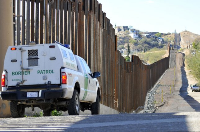 A Border Patrol truck sits along the border fence between the United States and Mexico in Nogalas, Arizona, December 15, 2011. UPI /Art Foxall