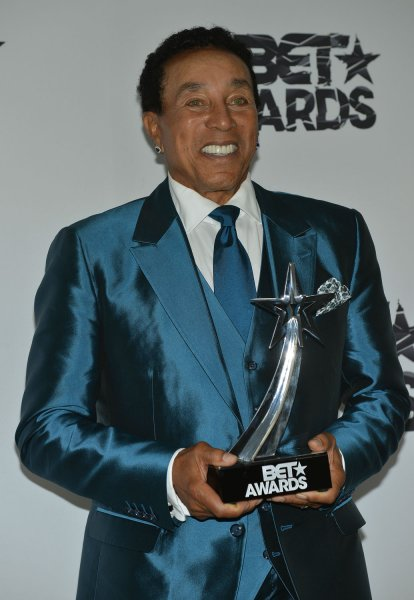 Smokey Robinson holds up his BET Lifetime Achievement Award in Los Angeles on June 28. File Photo by Christine Chew/UPI