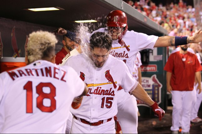St. Louis Cardinals' Yadier Molina gets in on the fun as he jumps while Carlos Martinez throws water on the face of Randal Grichuk after Grichuk's two run home run against the San Diego Padres in the seventh inning at Busch Stadium in St. Louis on July 18, 2016. St. Louis defeated San Diego 10-2. Photo by Bill Greenblatt/UPI