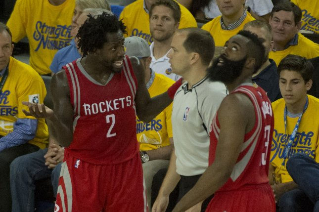 a60475668c4d Houston Rockets  Patrick Beverley (2) pleads a call with the ref as James  Harden watches the replay on the scoreboard in the second period against  the ...