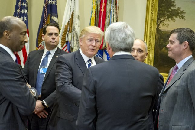 President Donald Trump meets with representatives from PhRMA, the Pharmaceutical Research and Manufacturers of America, at the White House on January 31, 2017. On Friday, the White House issued a series of proposals for reducing prescription drug costs for consumers. File Photo by Ron Sachs/UPI