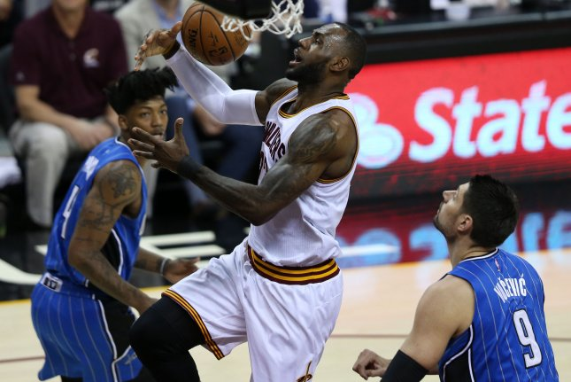 Cleveland Cavaliers forward LeBron James loses the handle on the ball while defended by Orlando Magic's Nikola Vucevic (9) and Elfried Payton at Quicken Loans Arena in Cleveland, Ohio. File photo by Aaron Josefczyk/UPI