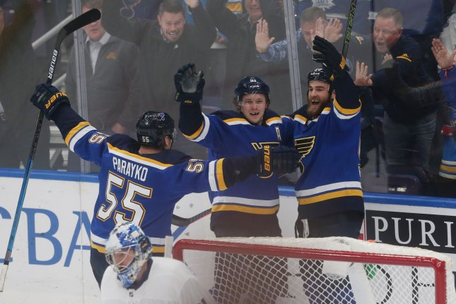 St. Louis Blues forward Ryan O'Reilly (R) celebrates his game-winning goal in overtime with teammates Vladimir Tarasenko and Colton Parayko against the Toronto Maple Leafs on Tuesday night at the Enterprise Center in St. Louis. The 3-2 victory for St. Louis sets an all-time franchise record with 11 straight wins. Photo by Bill Greenblatt/UPI