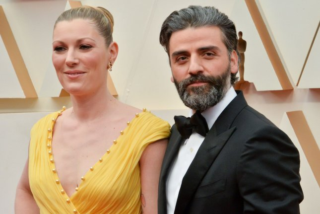 Oscar Isaac (R) and his wife Elvira Lind arrive for the 92nd annual Academy Awards on February 9. Isaac is set to star in Scenes From a Marriage alongside Michelle Williams. File Photo by Jim Ruymen/UPI