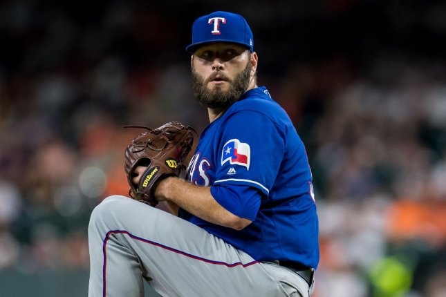 Pitcher Lance Lynn (pictured) will slide in behind Lucas Giolito and Dallas Keuchel in the Chicago White Sox rotation next season after he was acquired Tuesday in a trade with the Texas Rangers. File Photo by Trask Smith/UPI