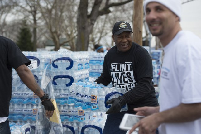 Michigan Gov. Gretchen Whitmer signed two bills into law on Wednesday approving the establishment of a $641 million trust fund to deliver settlement money to residents affected by the Flint water crisis. File Photo by Molly Riley/UPI