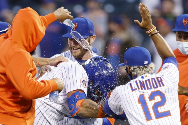 The New York Mets celebrate with Jonathan Villar (C) after his walk-off RBI single against the Philadelphia Phillies on Tuesday at Citi Field in Queens, N.Y. Photo by John Angelillo/UPI