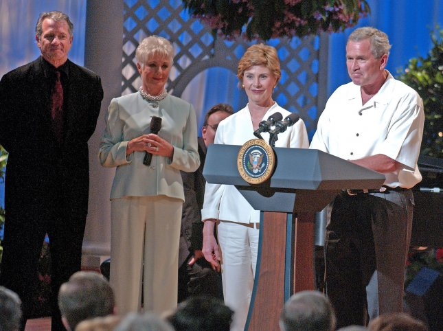 United States President George W. Bush and first lady Laura Bush make remarks at the annual Congressional Picnic Performance on the South Lawn of the White House in Washington, D.C. on June 15, 2005. From left to right: Tom Wopat, Shirley Jones, Laura Bush, President Bush. (UPI Photo/Ron Sachs/POOL)