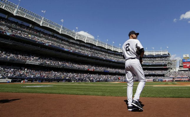 New York Yankees Derek Jeter stands on the field before the game on Derek Jeter Day when the New York Yankees play the Kansas City Royals at Yankee Stadium in New York City on September 7, 2014. Jeter announced in February that the 2014 season would be his last. UPI/John Angelillo