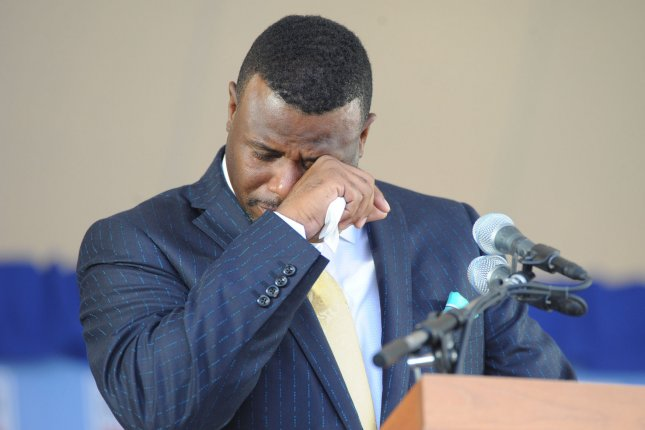 14b30e5c72 Seattle Mariners center fielder Ken Griffey Jr. wipes away tears as he  makes induction speech at the Baseball Hall of Fame induction ceremony in  Cooperstown ...