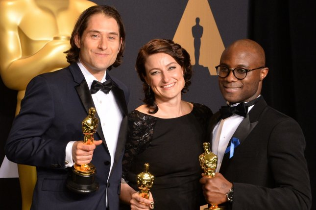 Producer Jeremy Kleiner (L), producer Adele Romanski (C), and writer/director Barry Jenkins, winners of the award for Best Picture for Moonlight appear backstage during the 89th annual Academy Awards on Sunday. The company in charge of counting Oscar nominations and votes, has aplogized for the on-screen snafu that saw La La Land orginally announced as the winner of Best Picture. Photo by Jim Ruymen/UPI