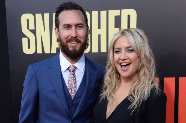 Kate Hudson (R) and Danny Fujikawa attend the Los Angeles premiere of Snatched on May 10. The actress couldn't help but gush about Fujikawa in a new interview. File Photo by Jim Ruymen/UPI