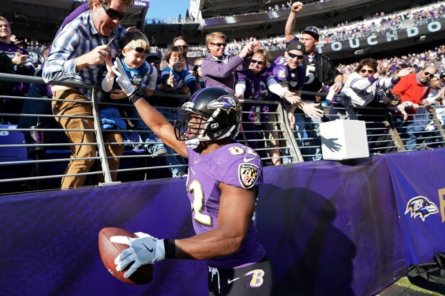 Former Baltimore Ravens tight end Benjamin Watson (82) celebrates with fans after scoring a one-yard touchdown against the Detroit Lions in the second quarter on December 3, 2017 at M&T Bank Stadium in Baltimore, Maryland. Photo by Kevin Dietsch/UPI