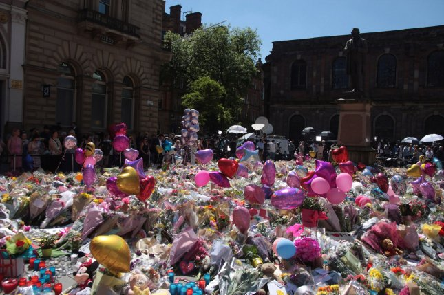 A makeshift memorial honors 22 people killed in the Manchester bombing on May 26, 2017. Tuesday, Britain will mark the first anniversary of the suicide attack with a moment of silence. File photo by Mushtaq Mohammed/UPI