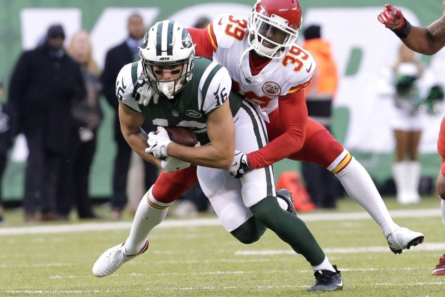 Former Kansas City Chiefs defensive back Terrance Mitchell gets on the back of ex-New York Jets wide receiver Chad Hansen in Week 13 of the NFL season on December 3, 2017 at MetLife Stadium in East Rutherford, New Jersey. File photo by John Angelillo/UPI