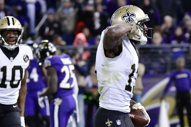 New Orleans Saints wide receiver Michael Thomas (13) celebrates a 5-yard touchdown reception from Drew Brees during the second half of an NFL game on October 21 at M&T Bank Stadium in Baltimore. Photo by David Tulis/UPI