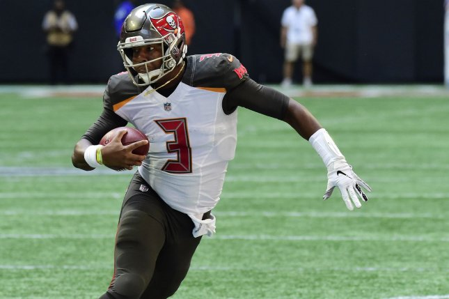 Tampa Bay Buccaneers quarterback Jameis Winston (3) evades a tackle on a first-down run during the first half on October 14, 2018 at Mercedes-Benz Stadium in Atlanta. Photo by David Tulis/UPI
