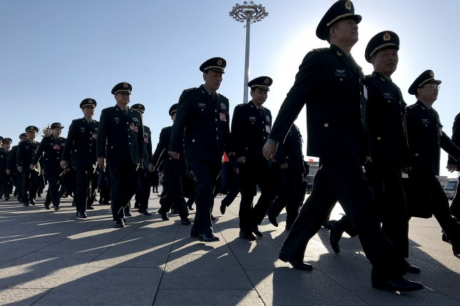 Chinese military delegates arrive for the closing ceremony of the 13th National People's Congress on Friday at the Great Hall of the People in Beijing, China. Photo by Stephen Shaver/UPI