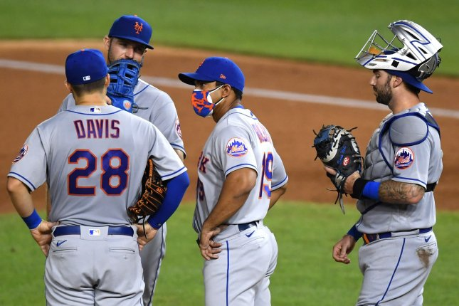 New York Mets manager Luis Rojas (C) talks to his team during a pitching change against the Washington Nationals on Aug. 4 at Nationals Park in Washington, D.C. The Mets had one player and one staff member test positive for the virus. Photo by Kevin Dietsch/UPI