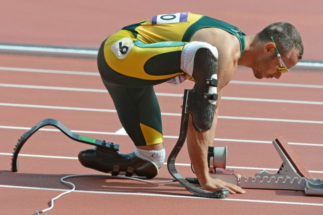Oscar Pistorius of South Africa adjusts the starting block for the first heat of the Men's 400M in the Track and Field competition at the Olympic Stadium in the London 2012 Summer Olympics (File/UPI/Terry Schmitt)