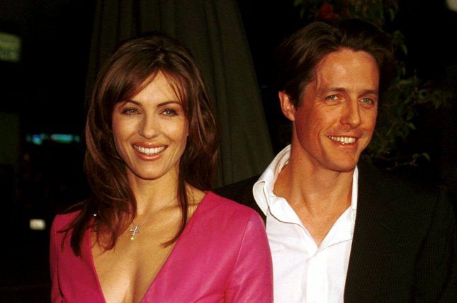 Elizabeth Hurley and Hugh Grant at the Los Angeles premiere of Mickey Blue Eyes in 1999. The actress said she and Grant remain best friends 16 years after their split. File Photo by Jim Ruymen/UPI