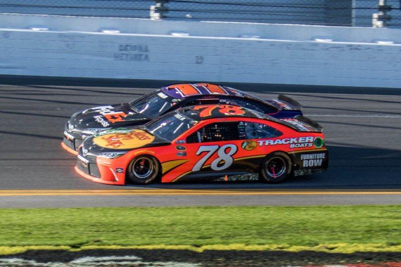 Denny Hamlin (11) and Martin Truex Jr (78) race the final 100yds to the finish of the closest finish in Daytona 500 history. Hamlin won at Daytona International Speedway on February 21, 2016 in Daytona, Florida. Photo by Edwin Locke/UPI