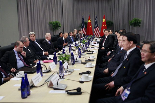 U.S and Chinese governments commit to Paris climate accord with the aim of encouraging other lead economies to follow suit. Pool Photo by Dennis Brack/UPI