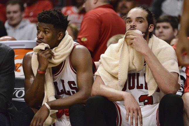 Chicago Bulls guard Jimmy Butler (L) and center Joakim Noah sit on the bench during the fourth quarter of game 6 of the Eastern Conference Semifinals of the NBA Playoffs against the Cleveland Cavaliers at the United Center on May 14, 2015 in Chicago. Photo by Brian Kersey/UPI