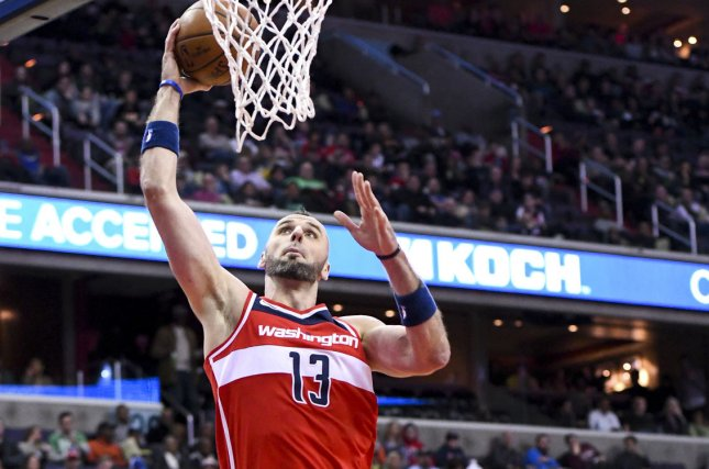 Washington Wizards center Marcin Gortat (13) scores in the first half on March 17 at Capital One Arena in Washington, D.C. Photo by Mark Goldman/UPI