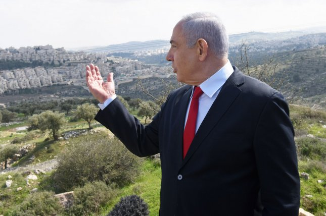 Israeli Prime Minister Benjamin Netanyahu announces a new neighborhood Thursday in the Israeli settlement Har Homa. Photo by Debbie Hill/UPI